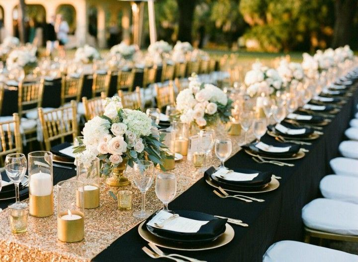 "Whoa. Talk about a glamorous Florida wedding! This celebration captured by Justin DeMutiis Photography is seriously the definition of ""Modern-Glam."" Everything from the sparkling gold decor to the classic black accents makes this one event that guests will always remembered. Under the sunlight, these reception tables shimmered fiercely, and we can't get enough. Take a look at more photos below for some amazing wedding inspiration!"