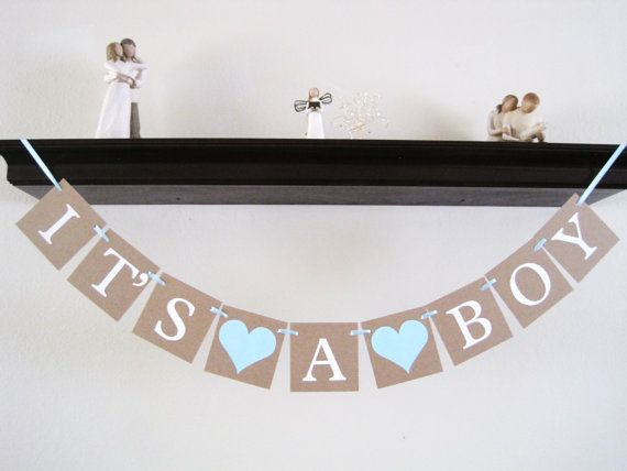 I can do this with scrapbook paper. Maybe even a few of them, so that each room/area has something. https://www.etsy.com/listing/179001061/its-a-boy-banner-baby-boy-banner-baby?ga_order=most_relevant&ga_search_type=all&ga_view_type=gallery&ga_search_query=baby%20boy%20shower%20decorations&ref=sr_gallery_4