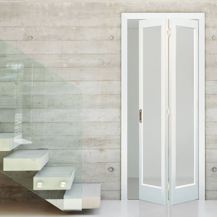 The Marston white primed interior door is engineered and faced with a pine or similar type of veneer and with a solid core and frosted safety glass. #glazedbifoldinternaldoors #internalwhitedoors #bifoldwhitedoorwithglass
