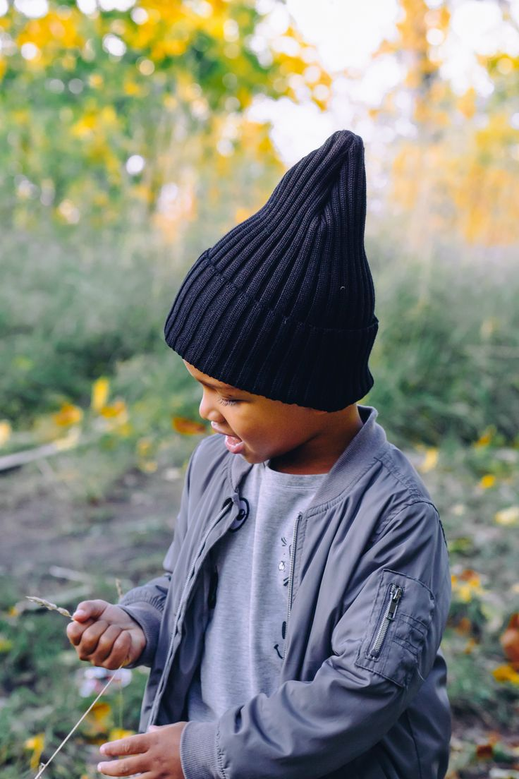 Comfy loose long black organic wool beanie for kids. Boys Fall outdoor outfit.