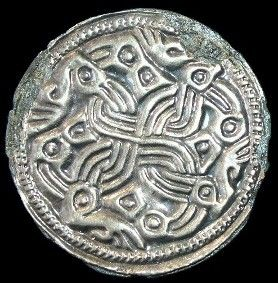 Dragons intertwined on Silver Viking Age disk brooch  9th century CE, England