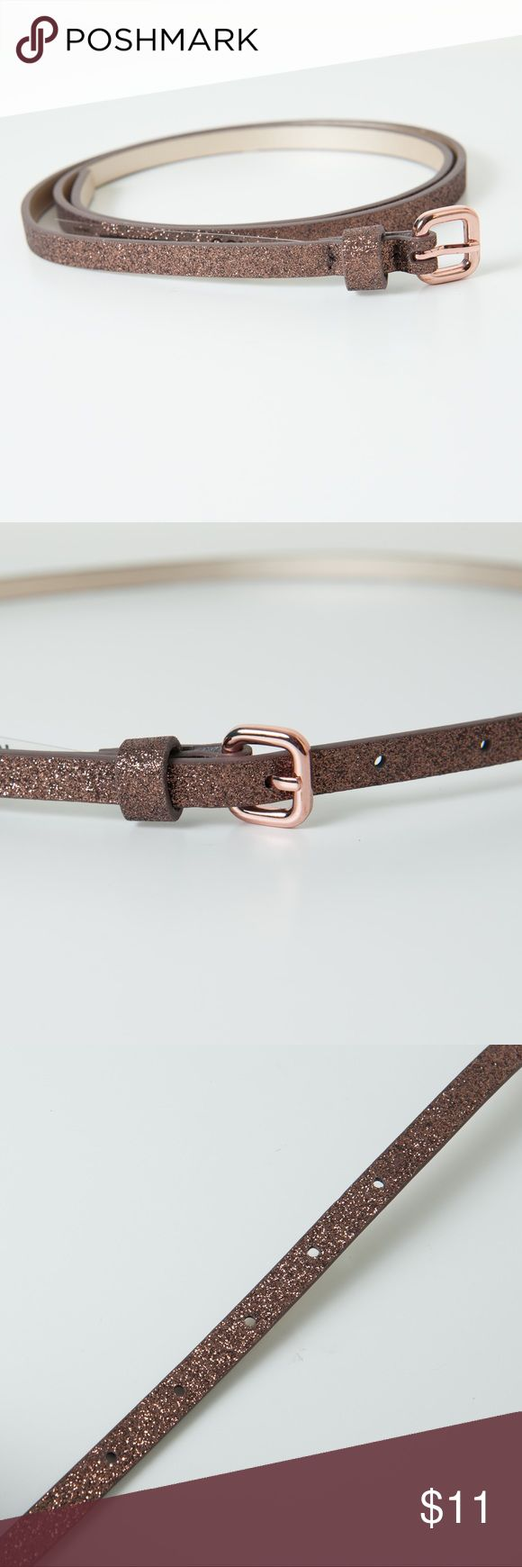 Joe Fresh Glitter Skinny Belt NWOT Bronze Gold Bronze/Gold glitter belt from Joe Fresh. New without tags. Get your daily dose of glamour with a glittery belt. Faux leather with glitter, 100% polyurthane Joe Fresh Accessories Belts