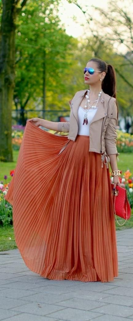 Pleated Skirt Outfit Idea #4. Wear a pleated maxi skirt with a white undershirt, blazer, and bright colored bag and flats.