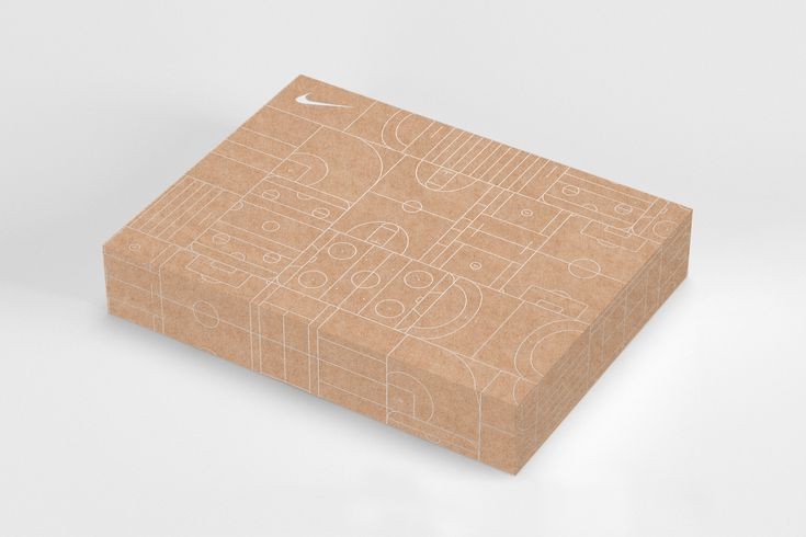 Agency: Character Client: Nike  Proposed packaging for Nike Global's online holiday gift packaging. The box  box uses a heavy-weight kraft stock, paired with a silver-foil pattern  built of various courts & terrains.