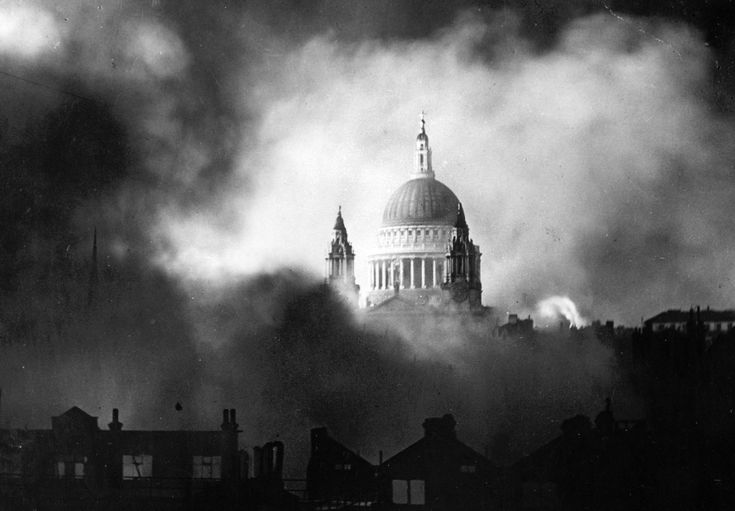 The dome of St. Paul's Cathedral (undamaged) stands out among the flames and smoke of surrounding buildings during heavy attacks of the German Luftwaffe on December 29, 1940 in London, England.