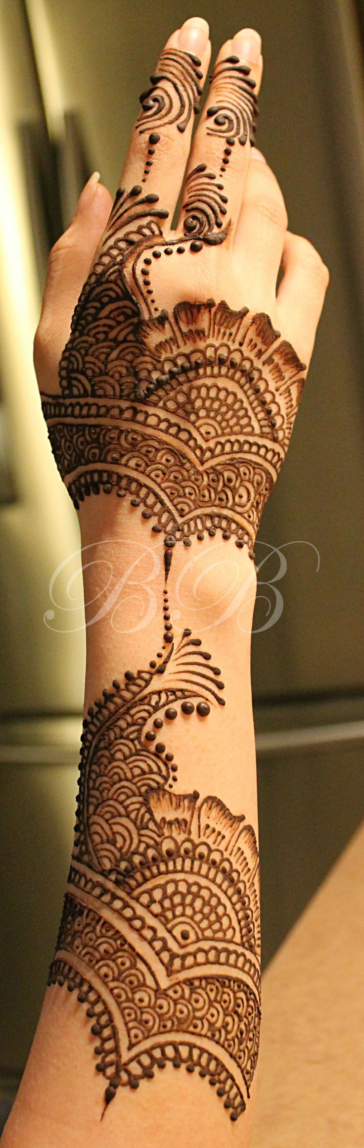 Detailed henna pattern with negative focal space to ensure a smooth flow of…