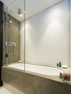 tub shower combo ideas | You can convert your bath into a shower combination by adding a pane ...