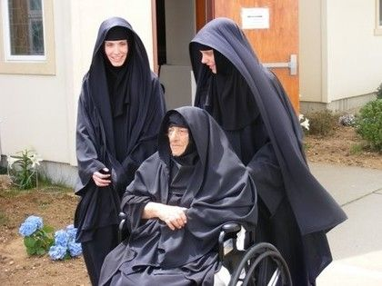 "In this picture, the nun in the wheel chair is sister Ypomoni (Patience) at the All Saints Monastery in Ridge, NY on Long Island. It was her dream to see a monastery open in the Long Island area and she always wanted to be a nun.  Her dream was finally achieved at the age of 92 which is why she is given the name ""Patience"".  About 1 1/2 years after she was tonsured a nun, she fell asleep in our Lord.  Truly a woman who was blessed."