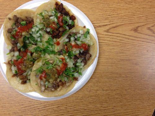 Un taco de asada, cabeza, buche, al pastor, carnitas from King Taco.