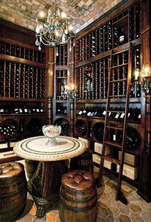 i like this a whole lot a slight change of floor ceiling table and chairs and this would be downright perfect with its dark wood laddered wine racks arched table top wine cellar furniture