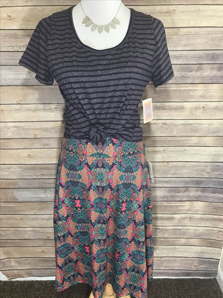 Super cute pattern mixing outfit with striped classic tee. And lularoe azure skirt. Styling tip