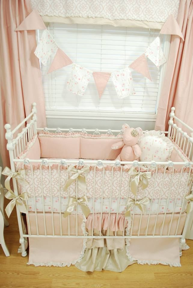 Shabby Chic pink crib bedding with floral fabric, lace and ruffles and golden bows made by Pine Creek Bedding