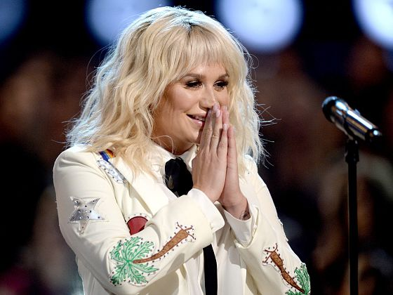 "Kesha shared the powerful meaning behind her first single in 4 years - Kesha released her new single ""Praying"" yesterday morning, after four long years of being trapped in music purgatory, unable to produce any new music due to contract restraints, and the ongoing court battle surrounding them. ""Praying,"" as described by Kesha in a personal essay she wrote for Lenny Letter , is all about triumphing through adversity, and finding peace in forgiving those who have hurt you. Kesha credits Ryan Lewis and Ben Abraham fo helping her ""channel all this raw emotion into a powerful song."" For the last few years, Kesha has been trying to free herself from her contract with Dr. Luke, her former producer and mentor whom she alleges drugged, and sexually and verbally assaulted her during her time recording with him at Sony. Sony finally removed Dr Luke from the company back in April, according to Pitchfork , and now Kesha's new album ""Rainbow"" is being released under his former label Kemosabe. In her Lenny Letter essay, Kesha also praises Jonas Åkerlund for helping her create the music video for ""Praying,"" which juxtaposes vivid, dark imagery (men wearing creepily realistic pig masks taunting Kesha), with brilliant, bright hues, and compelling visual effects — presumably a nod to Kesha overcoming her legal battles and eating disorder. Kesha describes her new album as ""just the beginning,"" and even the last scene of her music video is superimposed with the words ""The Beginning."" In ""Praying,"" Kesha sings: ""You brought the flames and you put me through hel / I had to learn how to fight for myself / And we both know all the truth I could tell / I'll just say this is I wish you farewell"" It seems like Kesha is saying goodbye to her painful past, and the result is a beautiful, soulful song, and a visually striking music video. Kesha's single ""Praying"" comes from her new album ""Rainbow,"" set to be released August 11. You can watch the music video for Kesha's new single ""Praying"" here: SEE ALSO: 'Spider-Man: Homecoming' could have a big $100 million opening at the box office Join the conversation about this story » NOW WATCH: 'It's an honor to be with you': Trump and Putin meet and shake hands ahead of their bilateral meeting at the G20"