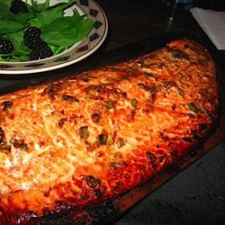 'Cedar Planked Salmon Recipe - This is a dish my brother prepared for me in Seattle. It is by far the best salmon I've ever eaten. I like to serve with an Asian inspired rice and roasted asparagus.'