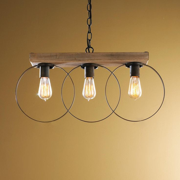 Three Ring Pendant Light with a modern shape, rustic finish, and weathered patina wood. A wonderful, whimsical fixture