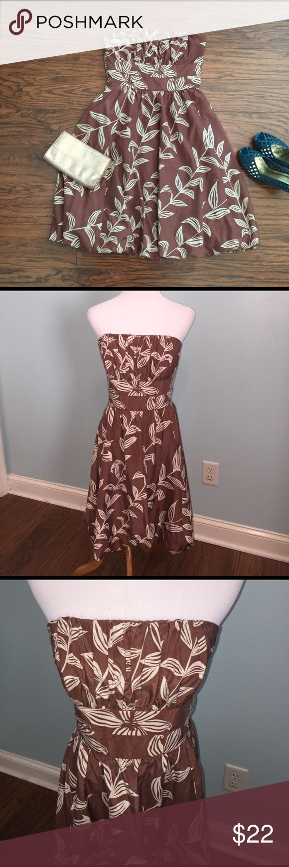 "Silk blend strapless dress Size 6. Beautiful brown silk blend sundress with cream leaf print. Bubble effect at bottom, lined top. Boning in top with unique ""bra"" hooks keep dress in place. Flattering shape. Cute dress for Spring! Silk/cotton blend. Dresses Strapless"
