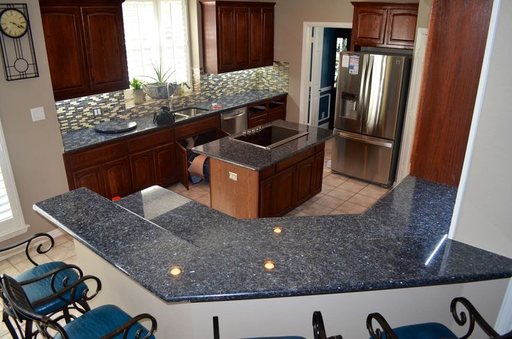 Blue Pearl granite counters with cherry cabinets. Visit globalgranite.com for your natural stone needs.