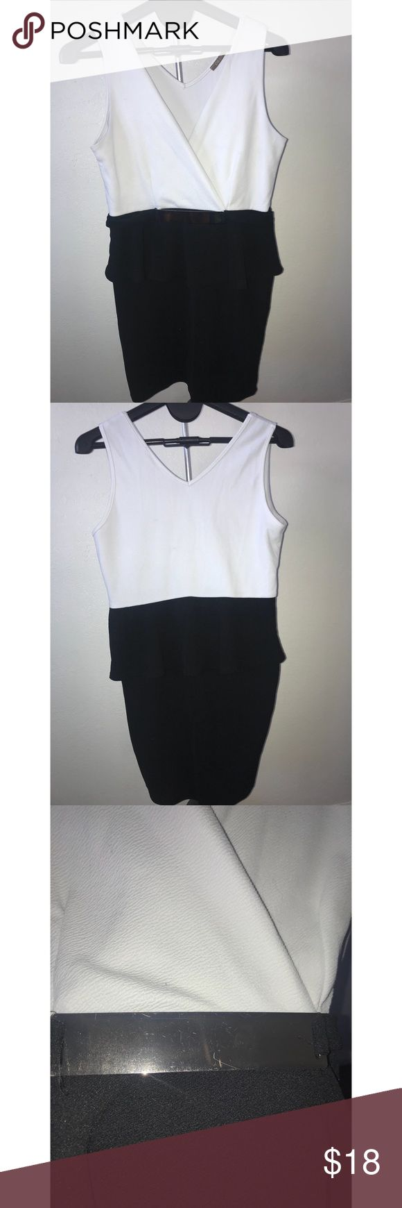 """Black and White Peplum Dress Black and white Libian peplum dress with gold accent belt. Length 36"""" Width 15"""" (stretchy)  Has a small pulled thread shown in photo. Libian Dresses"""