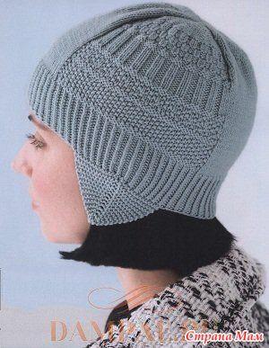 """Вязаная шапка с ушками украшена простым рисунком из сочетания лицевых и изнаночных петель. Описание вязания шапки переведено из журнала """"Vogue Knitting"""". Размер:"""