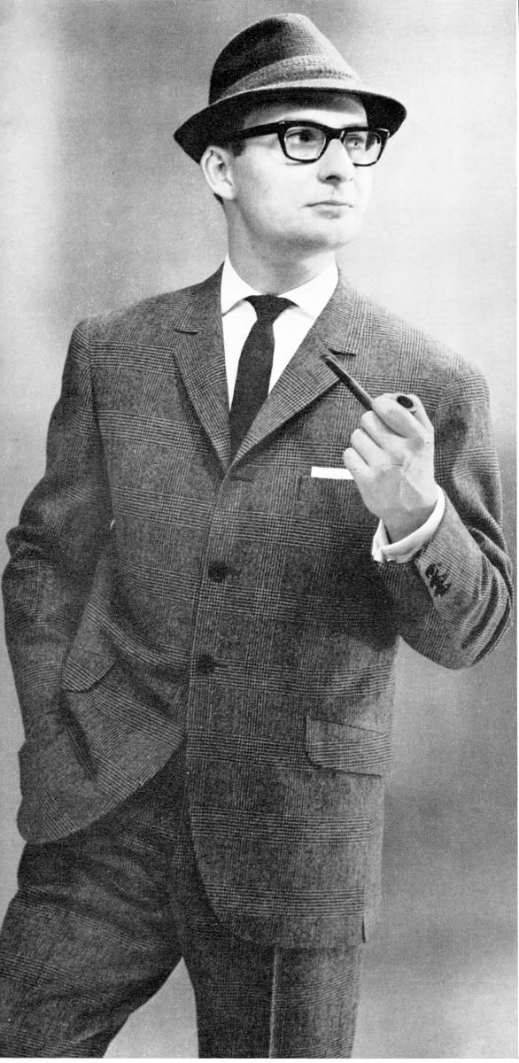 In the 1960s, this is what a man would wear to work. It was a very simple suit yet was very fashionable at the time.