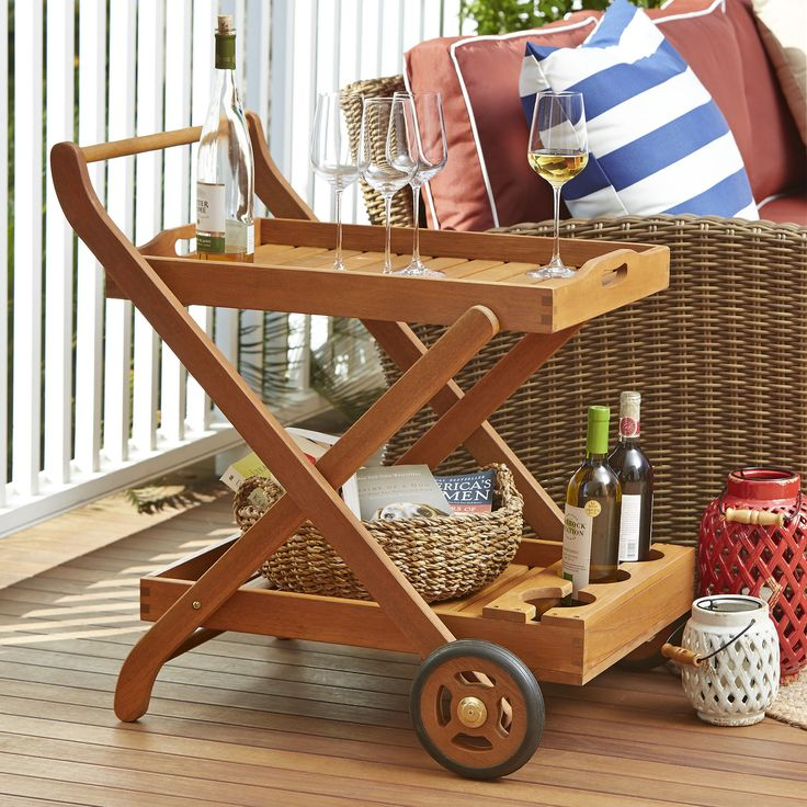 Eucalyptus Patio Serving Cart | Naturally oiled for outdoor use, this two-tier serving cart features a removable top tray plus front wheels that allow you to transport the party fare directly to your guests.