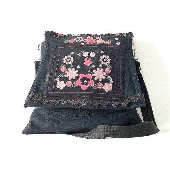 Black aplication recycled bag. denim jeans.Silki aplication in bloom.Fasten on magnet. Managed belt on sholder. Measurements;height 15 in [38 cm ] Width -lower line 16 in [40 cm],uper line 12,5 in [32 cm]