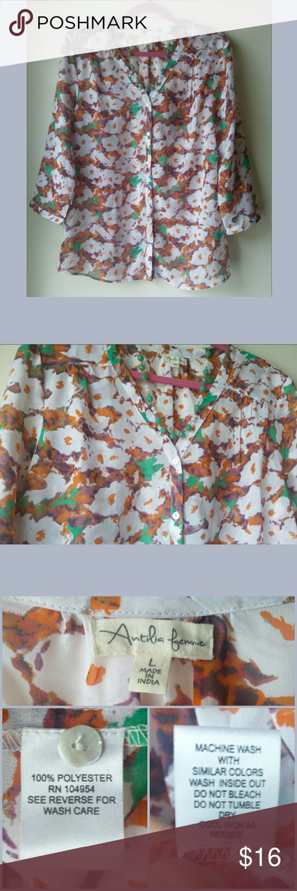 "Floral Blouse Very good used condition floral blouse. Gauzy, lightweight, and semi-sheer. The colors in this make it very versatile! Measures: 22"" armpit to armpit, 18.5"" sleeves, 28"" from shoulder to hem. The cut of this blouse is very straight and does not flare out at the hip. Probably better suited to a less curvy body type. Antilia Femme Tops Blouses"
