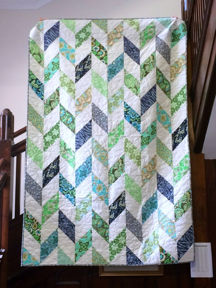 Daisy Chain quilt tutorial. Interesting method of piecing Herringbone pattern. Does not use HSTs.