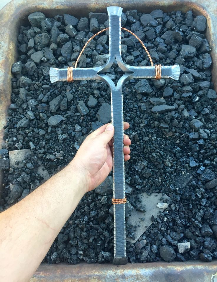 A personal favorite from my Etsy shop https://www.etsy.com/listing/265508199/epic-giant-forged-iron-blacksmiths-cross