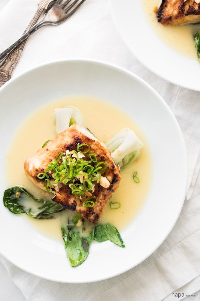 Miso-Glazed Halibut With Baby Bok Choy and Sake Butter Sauce #Recipe... This glorious entrée might look and sound fancy shmancy, but it's a cinch to make. Whether you're hosting a dinner party or simply looking to treat yourself to some at-home fine dinin