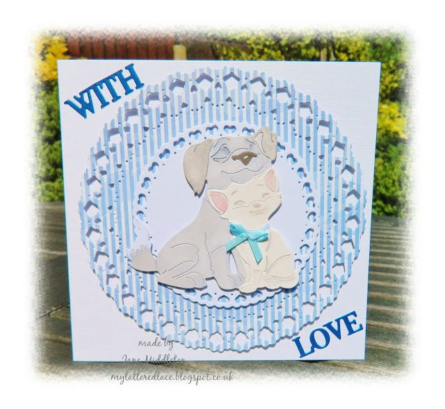 made by Jane Middleton  this was one of the free gift dies with the Tattered Lace magazine subsciption, as a lover of cats and dogs , it's a favourite of mine . dies used : Tattered Lace kitten cuddles  Tattered Lace with love ,Sweet dixie circle die ,paper from the works , all at sea blue bow , hobby craft .