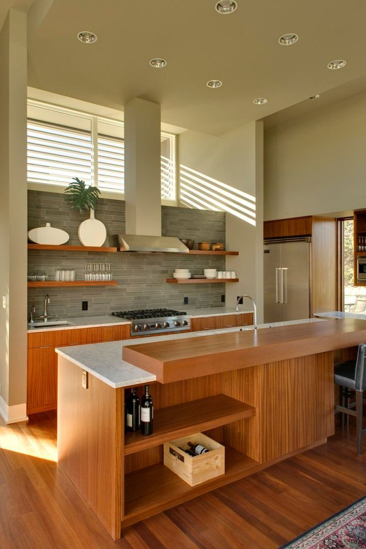 Kitchen Design Idea – 19 Examples Of Open Shelving | Open shelves on either side of the stove keep essentials at hand, while open shelving in the island keeps the wine on display but out of the way.