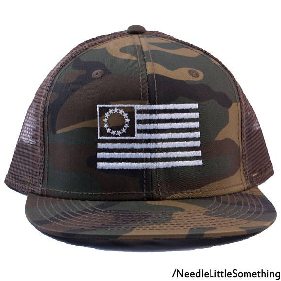 ★ See For Yourself Why We Havent Received Anything But 5 Star Ratings! ★ ► I T E M . S P E C I F I C A T I O N S ◄ - Description - A piece of history! Rock it old school with the 13 Colonies Flag embroidered in America on this camouflage netted Snapback cap. More Info •