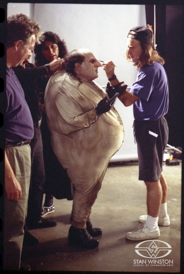 John Rosengrant touches up the Stan Winston Studio prosthetic makeup worn by Danny DeVito for his role in BATMAN RETURNS.