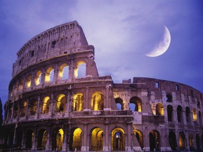 The Coliseum by moonlight, in Rome, Italy