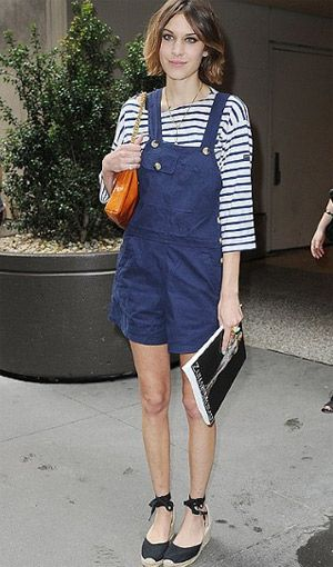 Alexa looks so great in dungarees. Very French with the striped top worn beneath the denim.