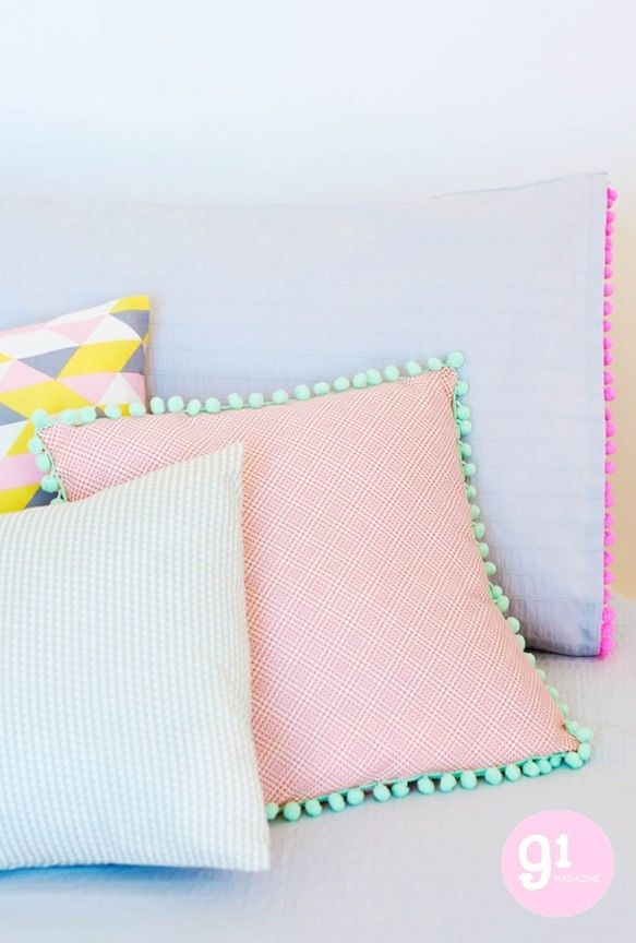Subtle patterns, washed out shades, neon trimmings - and POM POMS! I'd love these pillows in my apartment (but how would you wash them?)