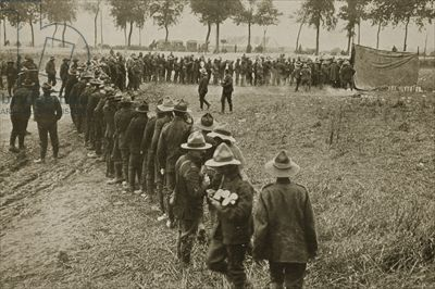 WWI, 1916; New Zealanders on the rank to get things from the field canteen. -Bridgeman Images