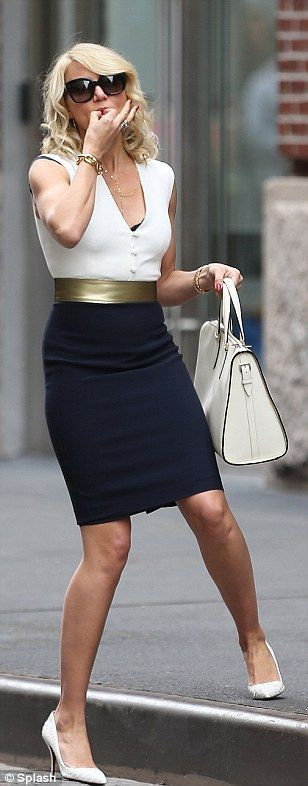 Scarlet woman Cameron Diaz ditches red frock for a sleeveless blouse as she goes…