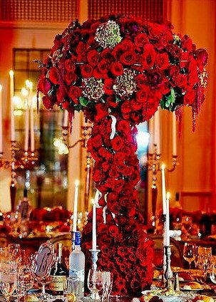 Spectacular red rose wedding reception centerpiece. So opulent and dramatic!