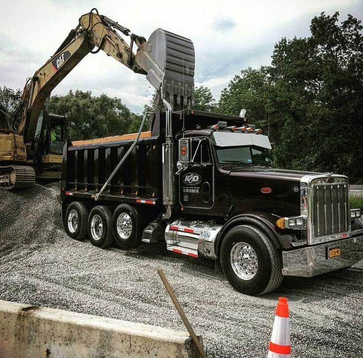 Peterbilt custom 379 tri axle dump gettin loaded up with a Cat excavator