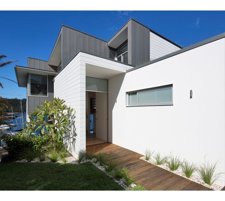 A three bedroom, family home built over three levels on the water's edge in Manly, on Sydney's Northern Beaches. Durable materials such as zinc, fibre cement cladding and sandstone are practical and give texture and interest to the building form.