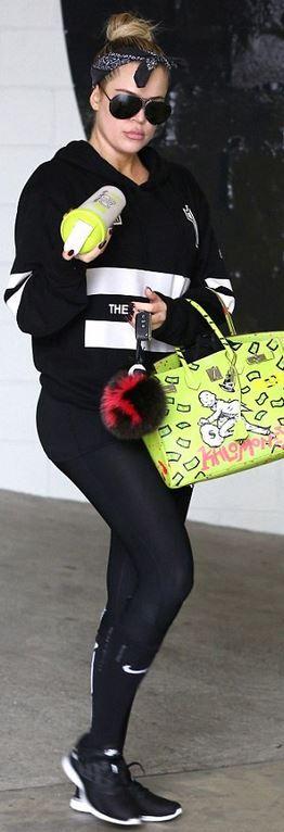 Khloe Kardashian: pants and shoes – Nike  Purse – Hermes  Key Chain – Fendi  sunglasses – Prosche