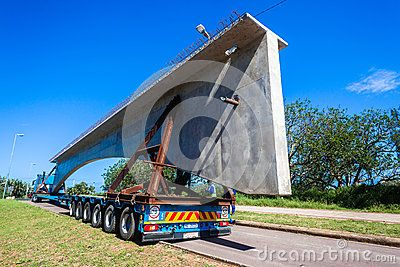 Abnormal Truck trailer load of fifty ton new concrete bridge section transported for construction onto Umgeni bridge Durban South-Africa