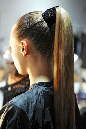 Slicked-back, shiny, high, and tight, this tail means business. To score this look, Roszak suggests starting on day-old hair that's been touched up with a flat iron so it's super-straight.