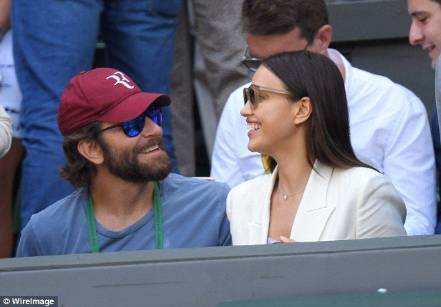Going strong: Irina Shayk and Bradley Cooper put on a loved-up display at the Wimbledon tennis championships in London on Wednesday