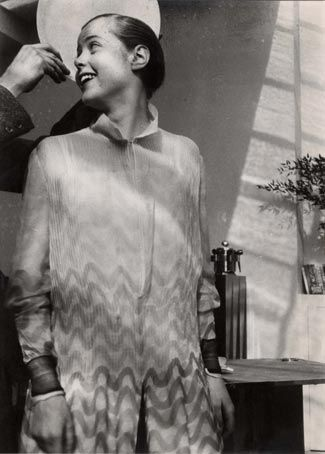 le corbusier puts a plate behind the head of charlotte perriand  to resemble a halo, 1928