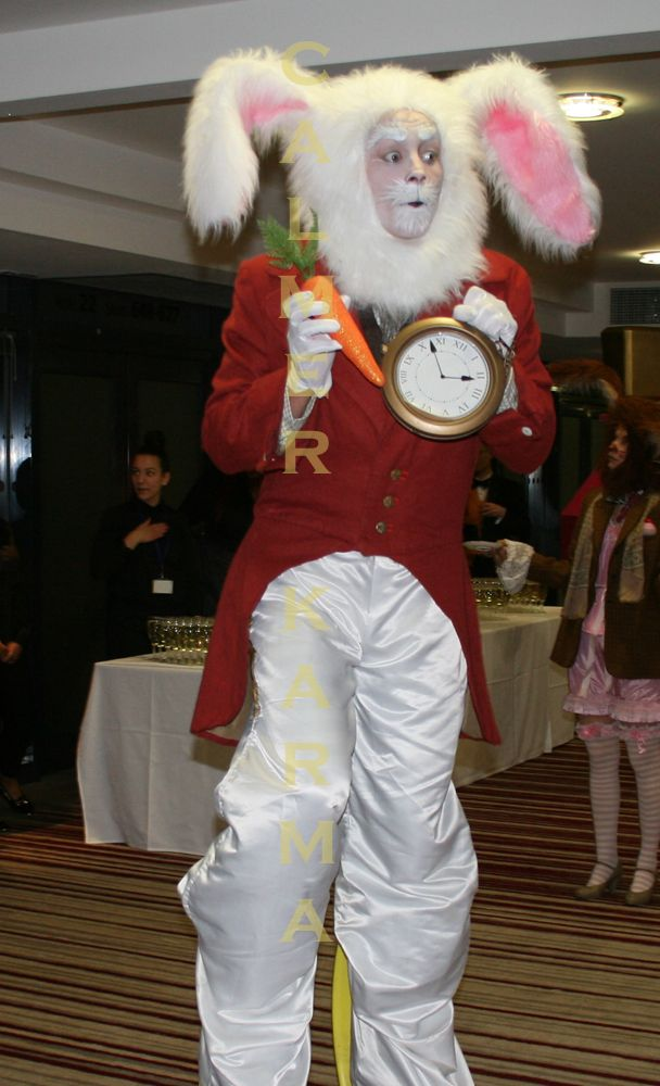 White Rabbit bouncy stilt jumping for joy as guests arrive at this stunning Alice in Wonderland themed corporate event.