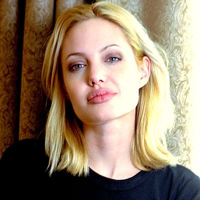 ANGELINA JOLIE - 1999 She went platinum for Girl, Interrupted, but limited her beauty routine to Carmex and lotion.