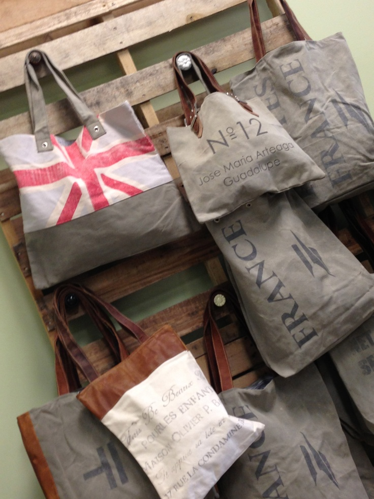 Pallet Wall Retail Handbag Display!  Add drawer knobs to pallets for a great handbag display wall.  Great idea!